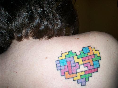 This colorful Tetris tattoo of Amy doesn't only show her love for the game,