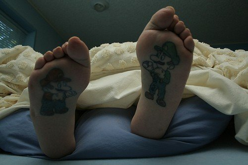 super mario brothers tattoos. The Mario brothers have been painted to