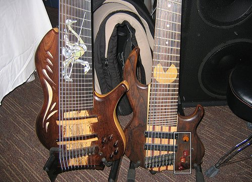 Imagine a bass Pacman guitar with wooden inlay of your favorite video games